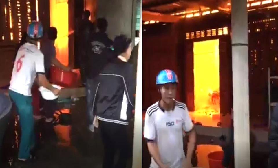 Hàng chục người dân cùng nhau dùng xô, chậu lấy nước dập lửa
