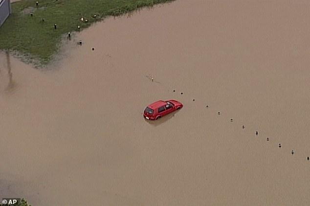 Khu vực bờ biển Gold Coast, bang Queensland chìm trong nước lũ vào thứ Bảy 18/1.