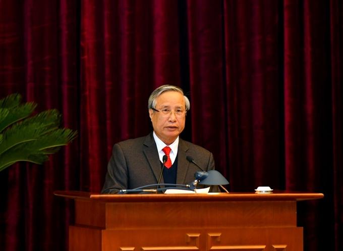 Đồng chí Trần Quốc Vượng, Ủy viên Bộ Chính trị, Thường trực Ban Bí thư báo cáo kết quả sau 4 năm thực hiện Nghị quyết Đại hội XII của Đảng