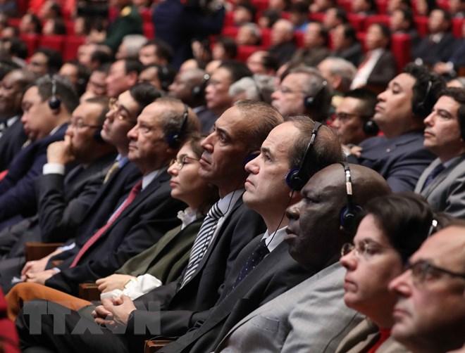 Đại biểu quốc tế tham dự Lễ kỷ niệm 90 năm ngày thành lập Đảng Cộng sản Việt Nam - Ảnh: TTXVN