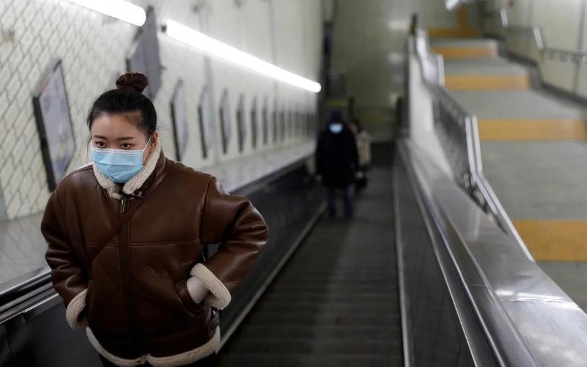 Người dân Bắc Kinh được yêu cầu đeo khẩu trang khi ra ngoài.
