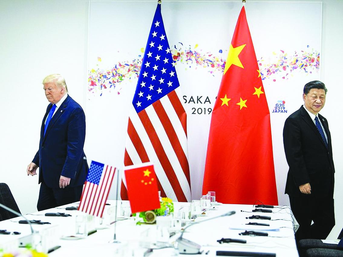 Tổng thống Mỹ Donald Trump và Chủ tịch Trung Quốc Tập Cận Bình tham dự cuộc họp song phương bên lề Hội nghị thượng đỉnh G20 tại Osaka tháng 6/2019 - Ảnh: AFP