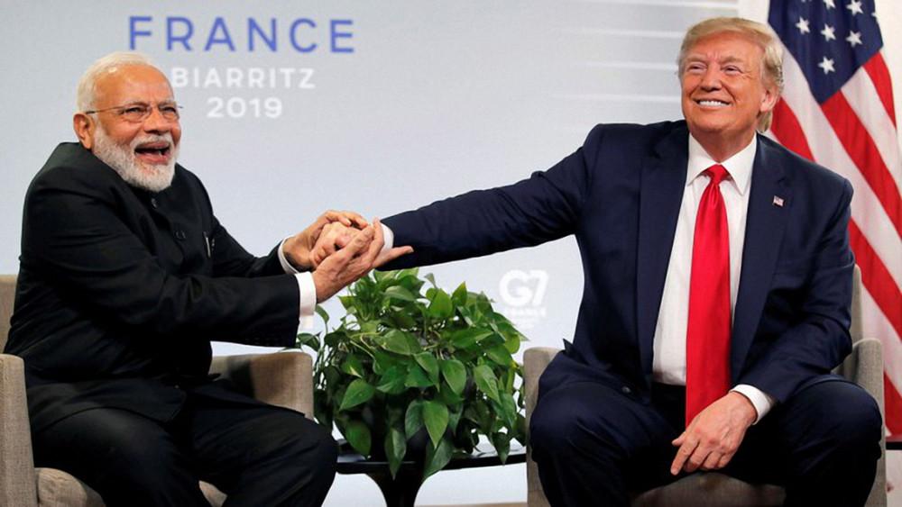 Thủ tướng Narendra Modi (trái) và Tổng thống Donald Trump có rất nhiều điểm tương đồng về hoạch định chính sách, nhưng họ lại đứng ở hai phía khác nhau trên cán cân thương mại
