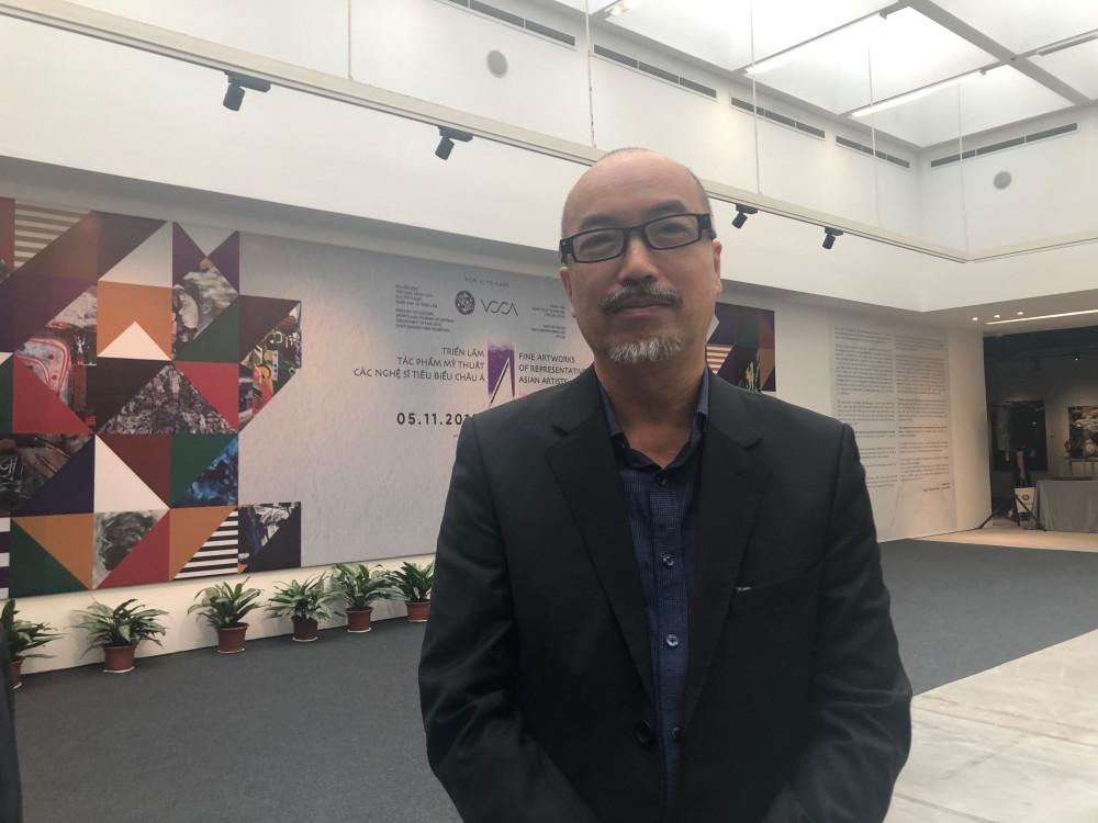 Ông Vi Kiến Thành tại một sự kiện triển lãm.