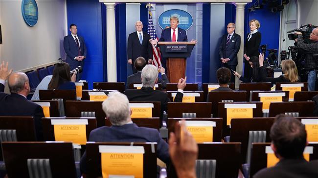 Tổng thống Donald Trump trong một cuộc họp báo ở Nhà Trắng ngày 24/3. Ảnh: AFP