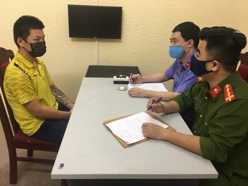 Nguyễn Bá Dũng tại Công an quận Đống Đa.