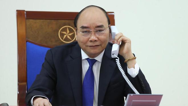 Thủ tướng Nguyễn Xuân Phúc điện đàm với Tổng thống Hoa Kỳ Donald Trump về tình hình phòng, chống dịch COVID - 19 - Ảnh: BNG