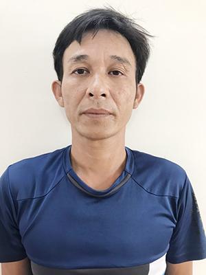 Đỗ Huy Hùng tại cơ quan công an