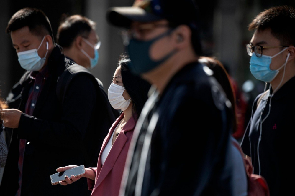 Trung Quốc đang chịu sức ép ngày càng tăng đối với việc xử lý đại dịch COVID-19 - Ảnh: AFP