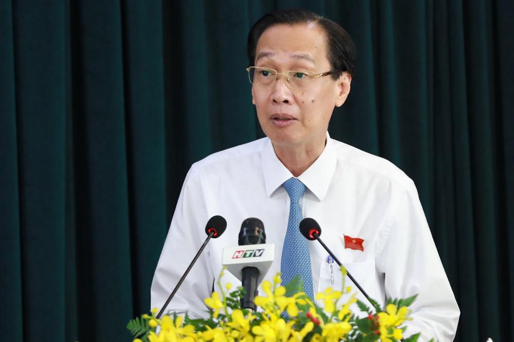 Ông Lê Thanh Liêm báo cáo tại Kỳ họp thứ 20 HĐND TPHCM khóa IX. Ảnh: Quốc Ngọc