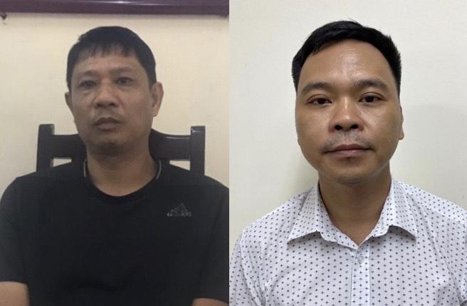 Hai bị can Bùi Quốc VIệt (trái) và Võ Việt Hùng