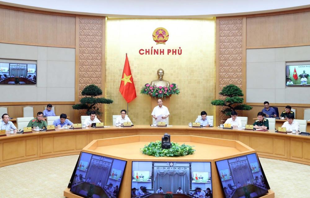 Thủ tướng Nguyễn Xuân Phúc tại cuộc họp - Ảnh: Thống Nhất