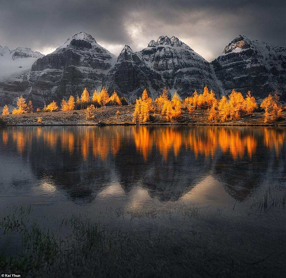 Trong ảnh là hồ Moraine nằm trong khu vực thung lũng Ten Peaks. Thung lũng này có 10 ngọn núi vây quanh, được đánh số từ 1 đến 10, nhưng gần đây đã có 3 đỉnh núi được đặt tên theo tên của những cá nhân xuất sắc. Hồ Moraine là nơi rất nổi tiếng với những người y6eu thích thiên nhiên. Bạn đã có thể nhìn thấy chúng ở hình nền của hệ điều hành Windows 7, màn hình đăng nhập của Windows 10 và ảnh nền trong hệ thống Google Andoid.