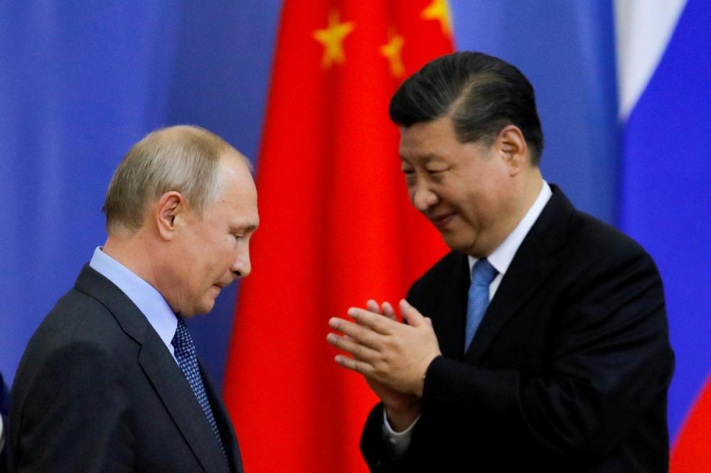 Tổng thống Nga Vladimir Putin và Chủ tịch Trung Quốc Tập Cận Bình - Ảnh: Reuters