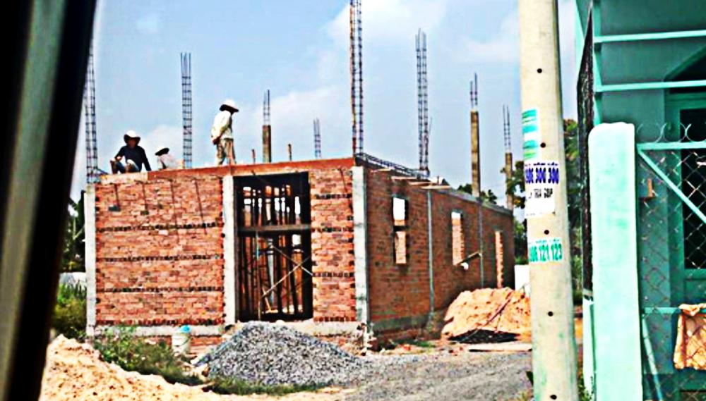 Thời điểm trước năm 2018, huyện Hóc Môn nở rộ vi phạm xây dựng do buông lỏng, bao che trong quản lý đô thị
