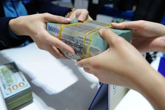 Nhiều ngân hàng giảm lãi suất kích cầu nền kinh tế - Ảnh minh họa