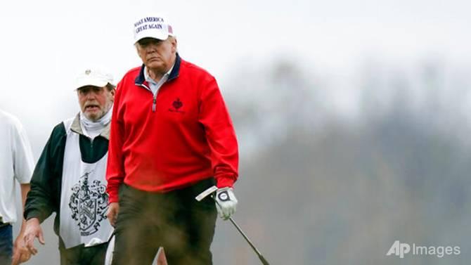 Tổng thống Trump bình thản đi chơi golf giữa hội nghị thượng đỉnh G20 đang diễn ra.