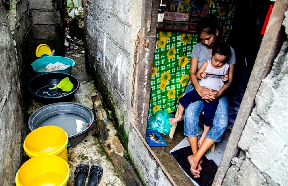 Các bà mẹ đơn thân và phụ nữ sống trong các hộ gia đình có thu nhập thấp đã bị ảnh hưởng nặng nề bởi đại dịch -Ảnh: Maro Enriquez
