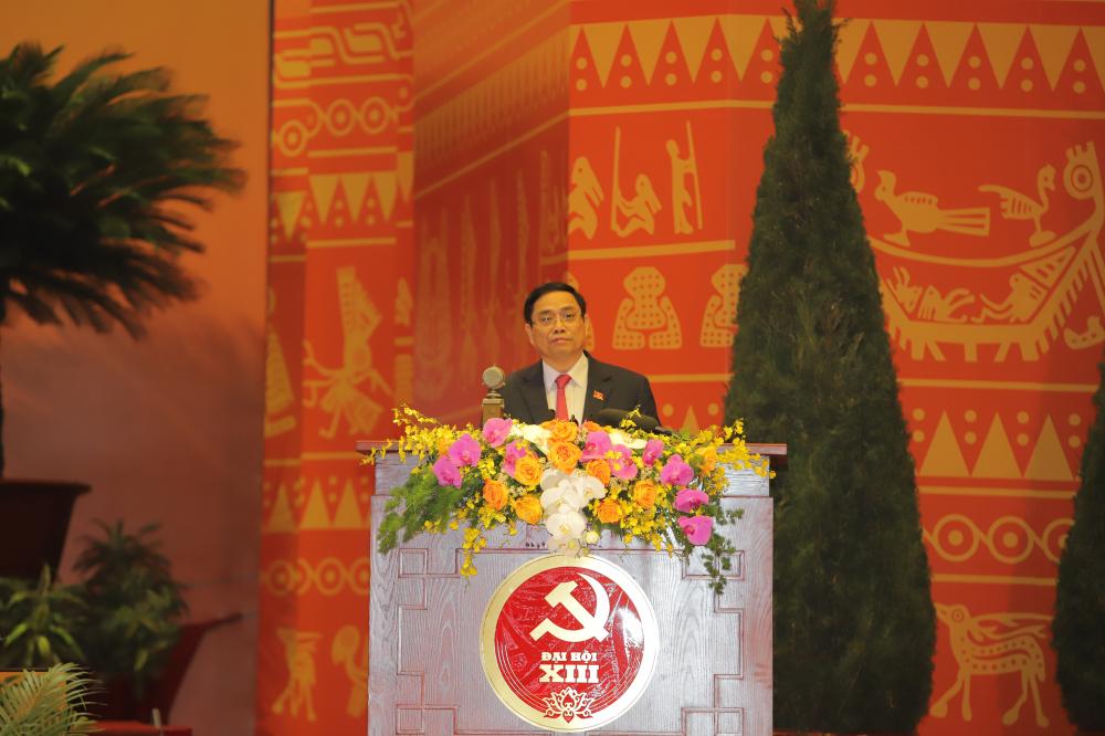 Ông Phạm Minh Chính, Trưởng Ban Tổ Chức Trung ương Đảng trình bày Quy chế làm việc, Quy chế bầu cử tại Đại hội.