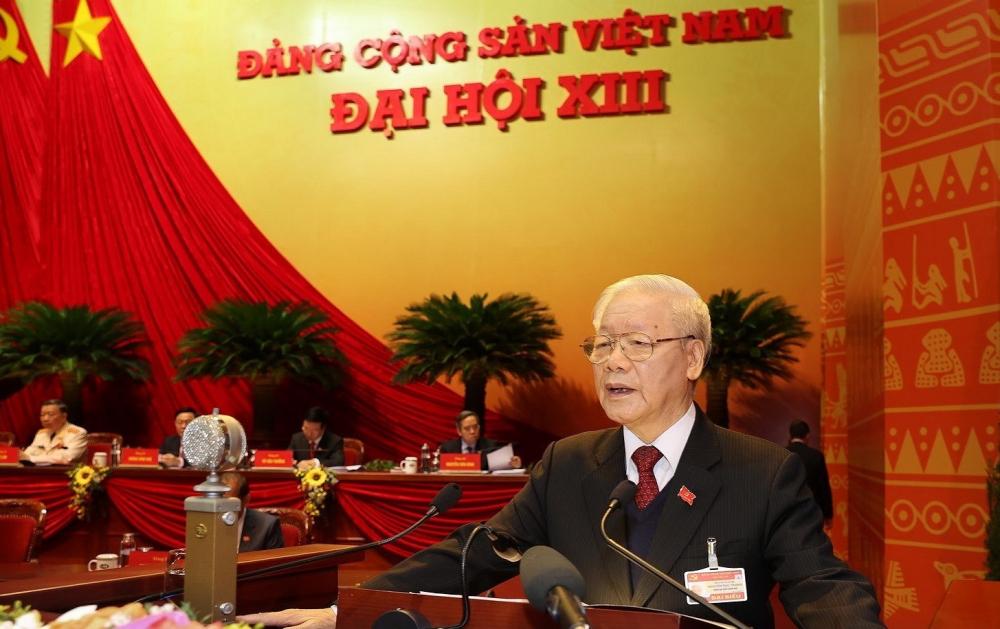 ổng Bí thư Ban Chấp hành Trung ương Đảng, Chủ tịch nước CHXHCN Việt Nam Nguyễn Phú Trọng đọc Báo cáo chính trị của Ban Chấp hành Trung ương Đảng khóa XII và các văn kiện trình Đại hội.