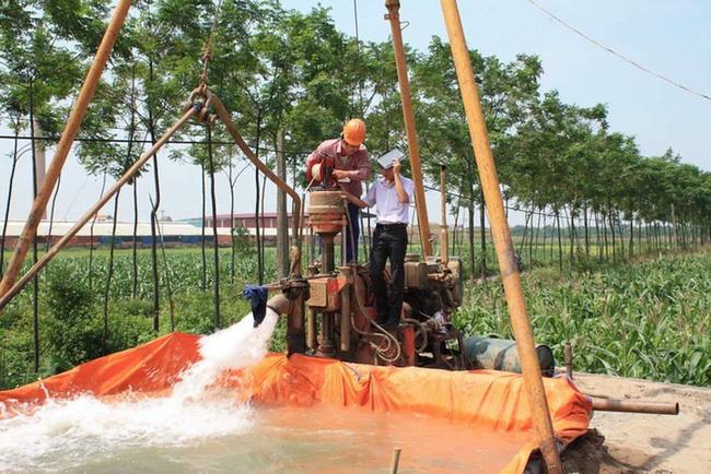Khai thác nước ngầm tại TPHCM - Ảnh: TGTT