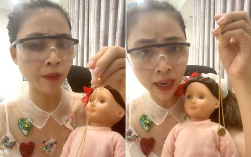 Hình ảnh Thơ Nguyễn ôm búp bê được cắt từ đoạn clip