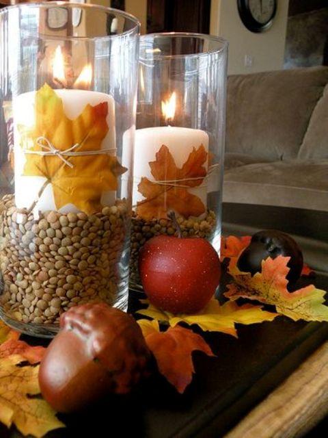 Hình 8. Mang không khí thu đông vào nhà với tín hiệu sang thu như lá đỏ, táo ,sồi, hạt,…làm nền cho ánh nến trung tâm được đặt trong ly làm nổi bật không khí phấn khởi,  ngọt ngào, ấm áp lan tỏa khắp ngôi nhà.