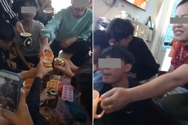 Hình ảnh cô giáo cổ vũ học sinh uống bia (ảnh cắt từ clip)