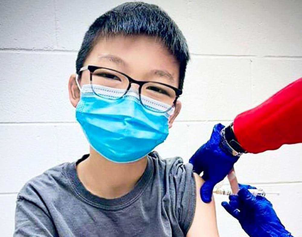 Tuy ít chịu ảnh hưởng nghiêm trọng do COVID-19, trẻ em cần được bảo vệ bằng vắc-xin  để tránh lây nhiễm và có thể quay lại trường học - Ảnh: Getty Images