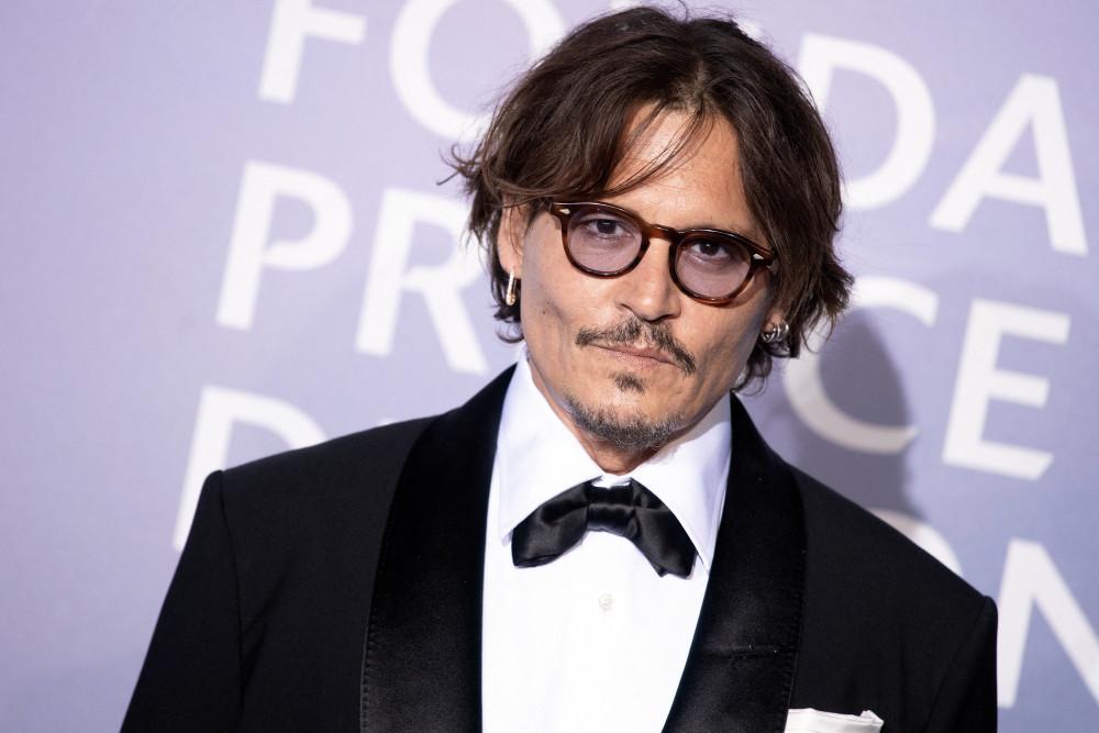 Johnny Depp thua kiện vợ cũ tội bạo hành.