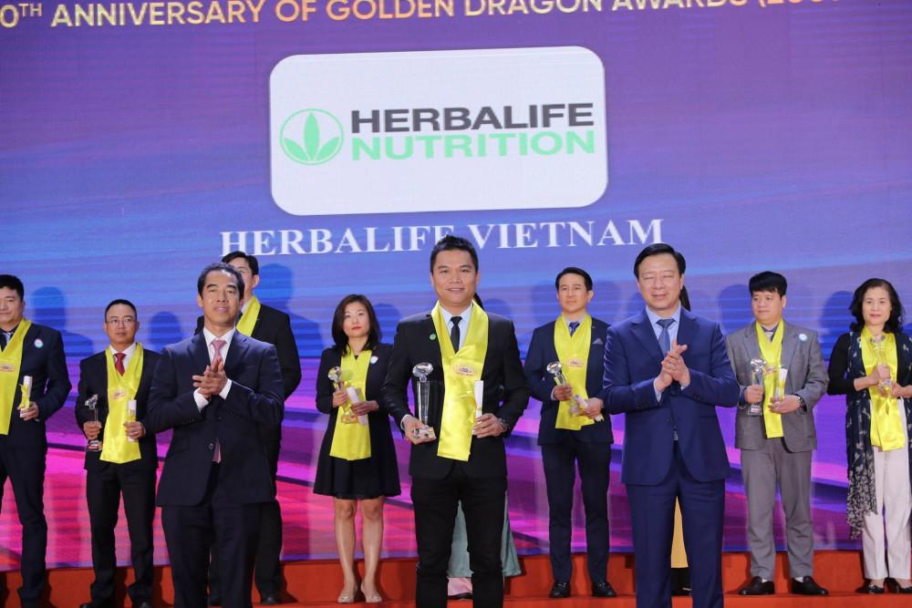 """Herbalife - """"Thương hiệu thực phẩm bổ sung dinh dưỡng hàng đầu"""" tại giải thưởng Rồng Vàng năm 2021. Ảnh: Herbalife"""