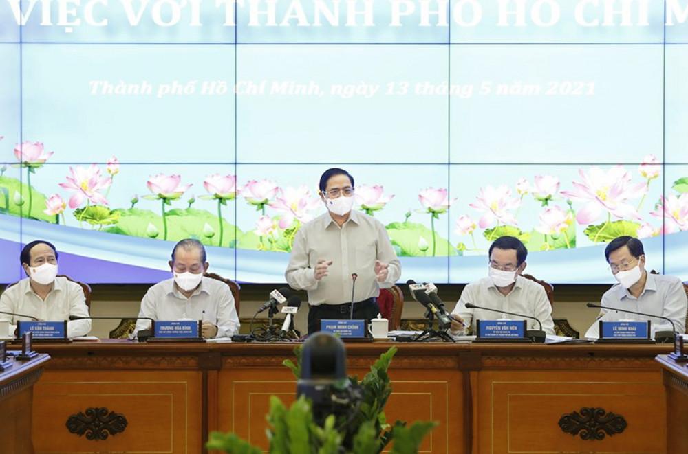 Thủ tướng Chính phủ Phạm Minh Chính làm việc tại TP.HCM sáng 13/5 - Ảnh: TTXVN