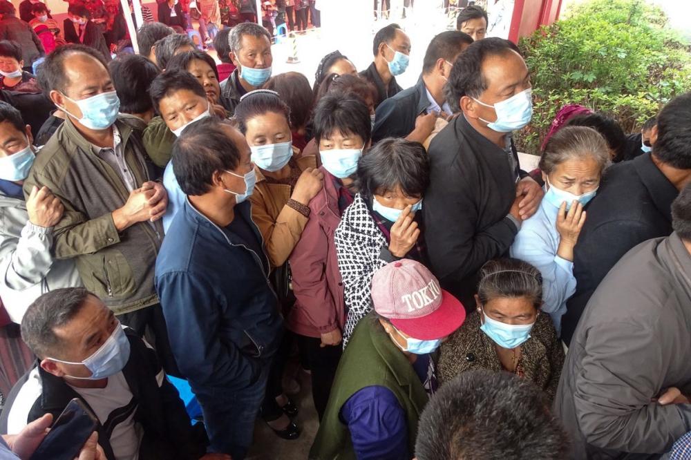 Trung Quốc tiến hành tiêm chủng cho gần 14 triệu người mỗi ngày - Ảnh: Bloomberg