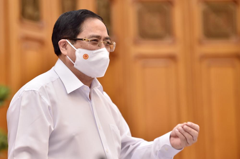 Thủ tướng Chính phủ Phạm Minh Chính chủ trì cuộc họp Thường trực Chính phủ về việc mua vắc-xin phòng COVID-19.