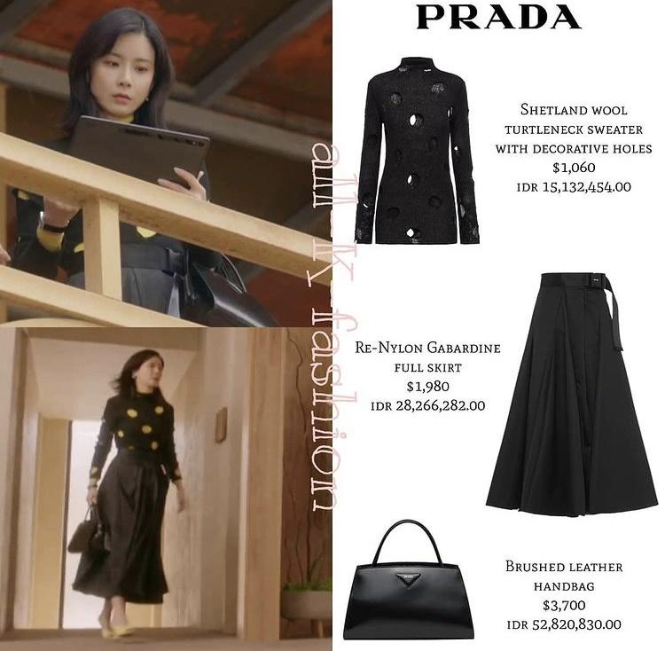 Lee Bo Young diện set Prada sắc đen toàn tập từ áo sweater họa tiết chấm bi, chân váy xòe đến túi xách. Tổng giá trị của bộ cánh này là 157 triệu đồng.