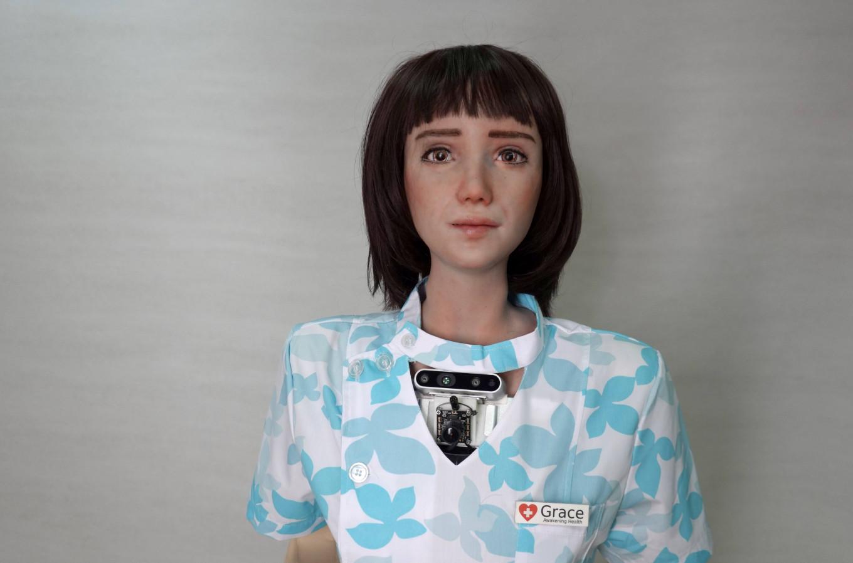 Cô y tá robot tên Grace được sử dụng để hỗ trợ đội ngũ nhân viên y tế khi phải tiếp xúc với người cao tuổi, bệnh nhân ở những khu vực bị cách ly vì COVID-19 - Ảnh: Joyce Zhou/