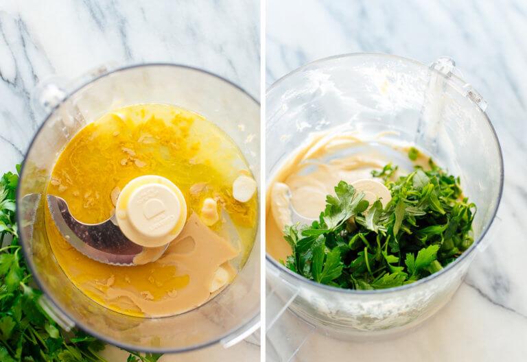 THÀNH PHẦN  ¼ cốc tahini ¼ cốc nước chanh tươi (khoảng 1 quả chanh lớn) 2 muỗng canh dầu ô liu, cộng với nhiều hơn nữa để phục vụ ½ chén rau mùi tây tươi cắt nhỏ, đóng gói lỏng ¼ chén được cắt nhỏ, gói lỏng bằng ngải giấm hoặc húng quế tươi 2 đến 3 muỗng canh hẹ hoặc hành lá tươi băm nhỏ 1 tép tỏi lớn, băm nhỏ ½ muỗng cà phê muối, thêm vừa ăn Một lon đậu gà (15 ounce), còn được gọi là đậu garbanzo, để ráo và rửa sạch 1 đến 2 muỗng canh nước, tùy chọn Trang trí thêm dầu ô liu và rắc rau thơm tươi cắt nhỏ