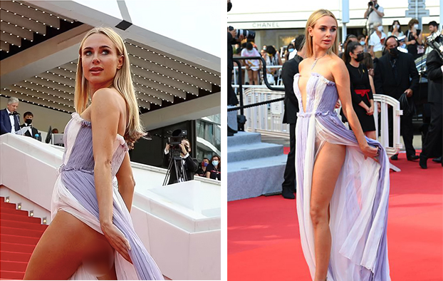 Trong vài phút ngắn ngủi trên thảm đỏ, người mẫu nội y 30 tuổi, liên tục vén chiếc váy đến từ thương hiệu La Metamorphose