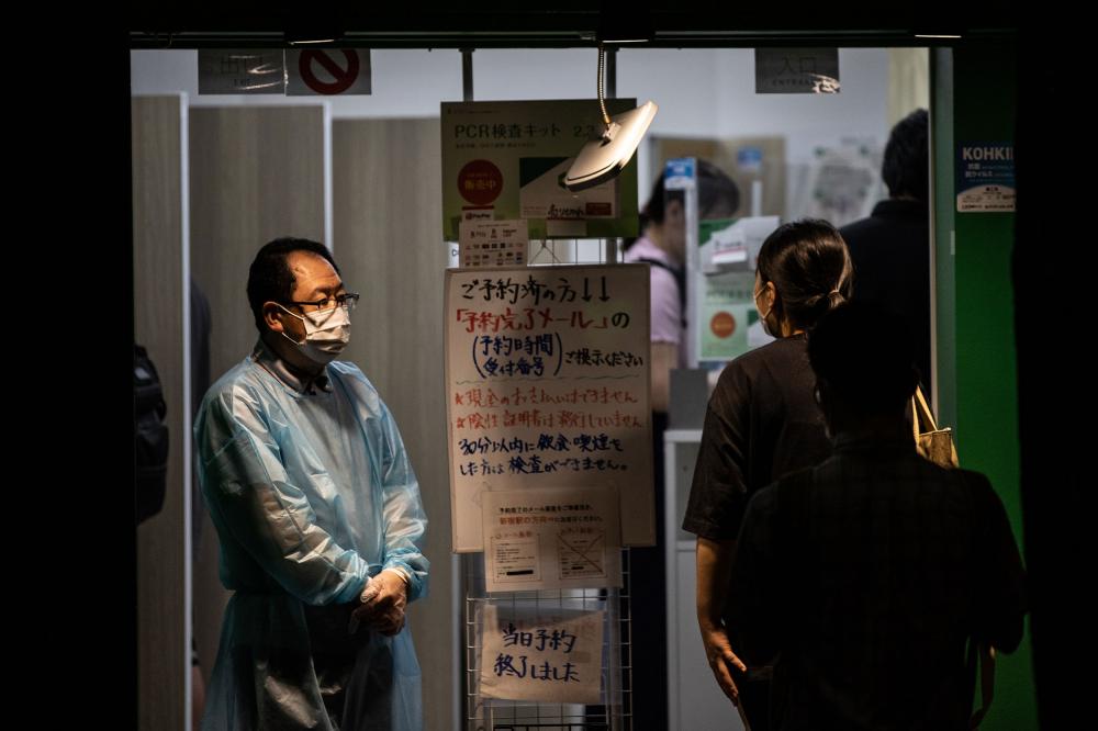 Trung tâm xét nghiệm COVID-19 khẩn trương hoạt động ở Tokyo trước ngày khai mạc Thế vận hội Mùa hè vào ngày 23/7 - Ảnh: CNN/Getty Images