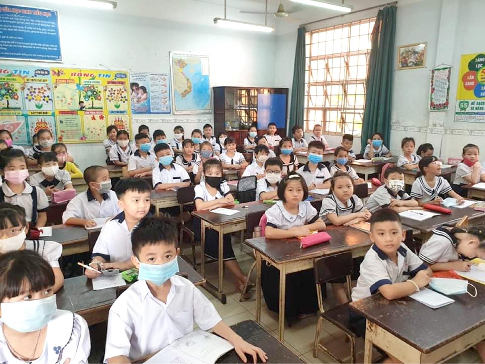 Học sinh Trường tiểu học Lê Văn Thọ (Q.12, TP.HCM) - một trong những trường có áp lực tuyển sinh đầu cấp - ẢNH: PHÚC TRẦN
