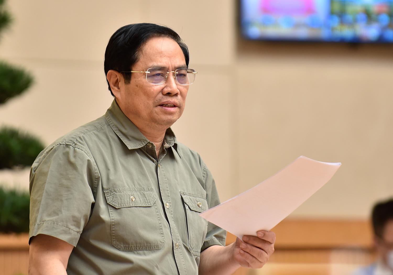 Thủ tướng Chính phủ Phạm Minh Chính đánh giá, bên cạnh những kết quả đã đạt được, công tác phòng chống dịch thời gian qua vẫn còn một số hạn chếsản xuất, kinh doanh  - Ảnh: VGP
