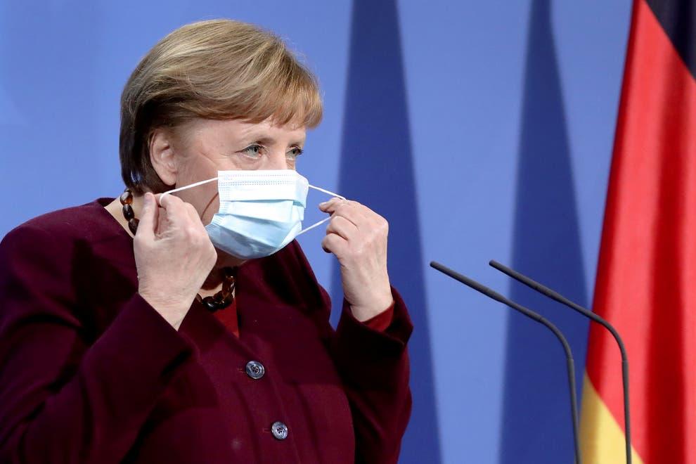 Thủ tướng Angela Merkel trong một cuộc họp báo về COVID-19 - Ảnh: Reuters