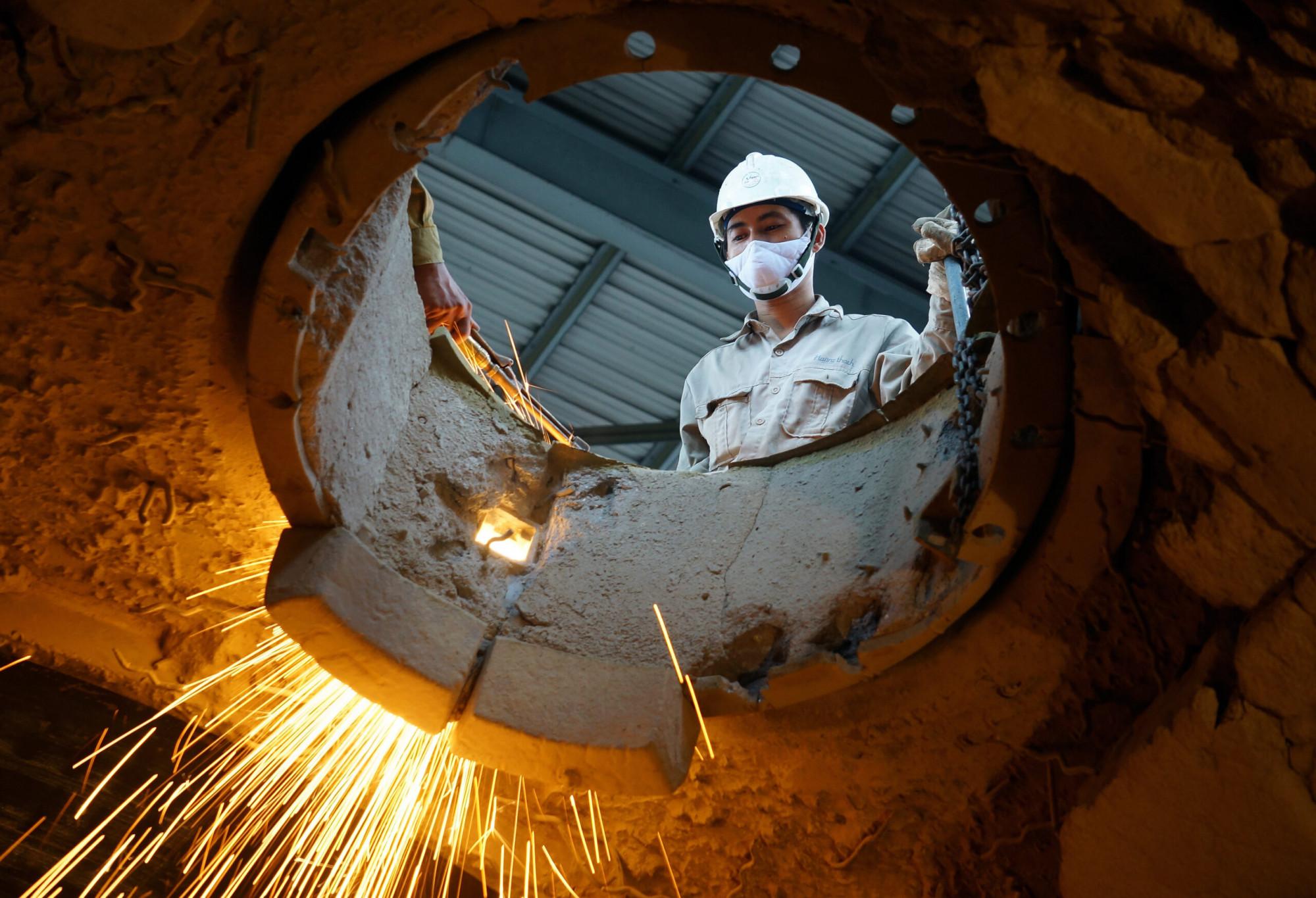 Nhà nước cần có sự phối hợp với DN để tháo gỡ những bất cập, phục hồi tái sản xuất. (Ảnh minh hoạ)