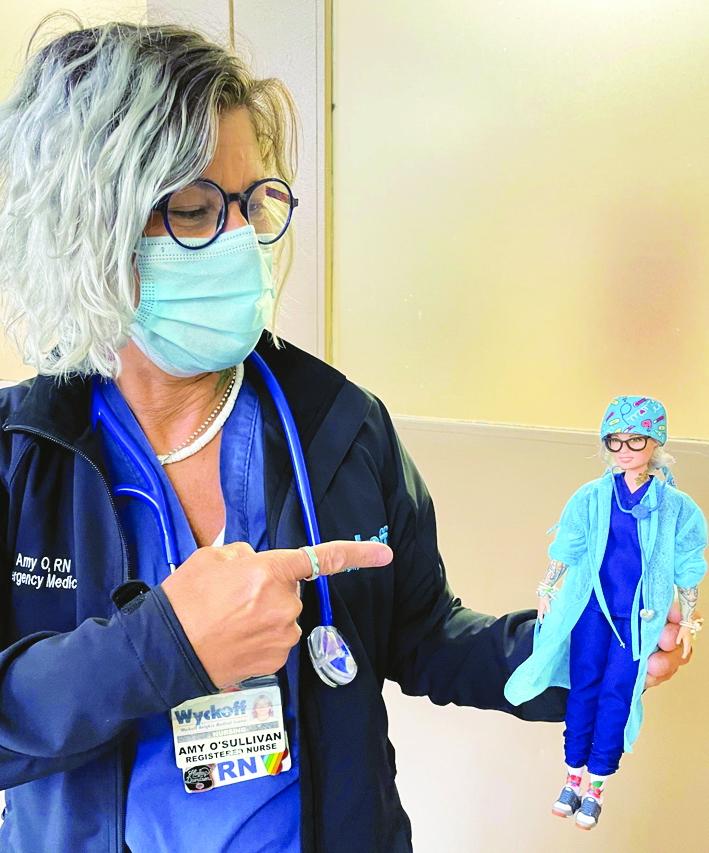 Y tá Amy O'Sullivan thích thú khi búp bê Barbie được mô phỏng theo cô tỉ mỉ đến từng hình xăm - Ảnh: TIME