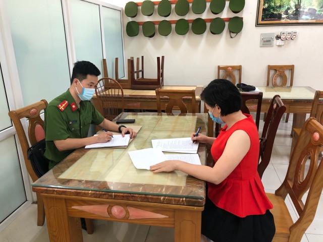 Phạm Thị Ngọc Mai tại cơ quan Công an.