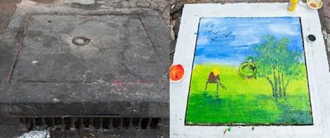 Nắp cống bẩn biến thành những bức tranh sinh động ở Sài Gòn
