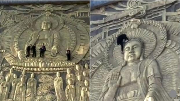 Du khach Trung Quoc than nhien treo len buc phu dieu 1.000 nam tuoi