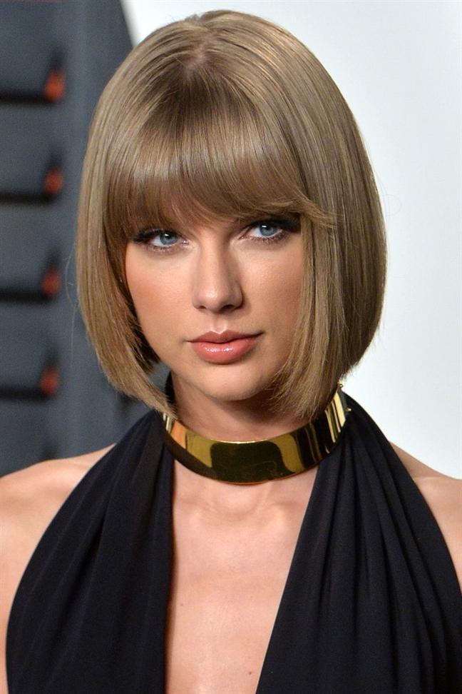 Kieu toc giup Taylor Swift khi lanh lung, luc quyen ru suot 12 nam qua