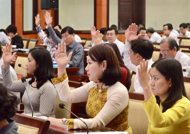 HDND TP.HCM thong nhat thong qua to trinh giam hoc phi bac THCS