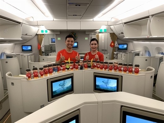 Doi tuyen Viet Nam dang tren chuyen bay roi Malaysia ve Viet Nam